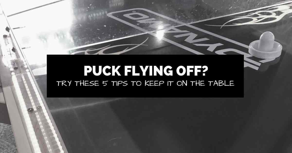 air hockey table with text about pucks flying off