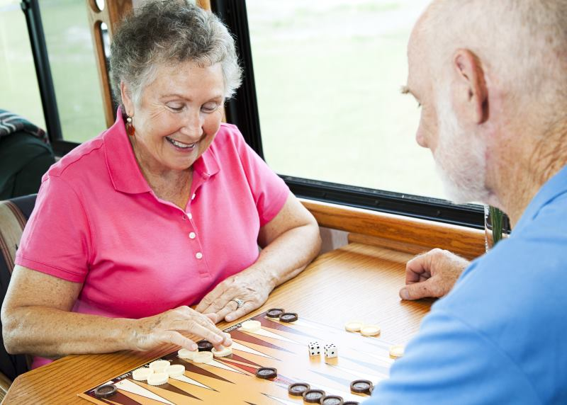 senior couple playing board games