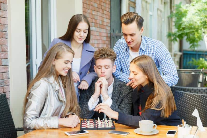 teens playing a board game
