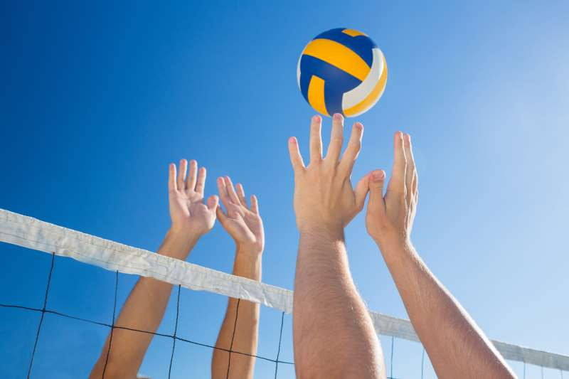 hitting volleyball over the net