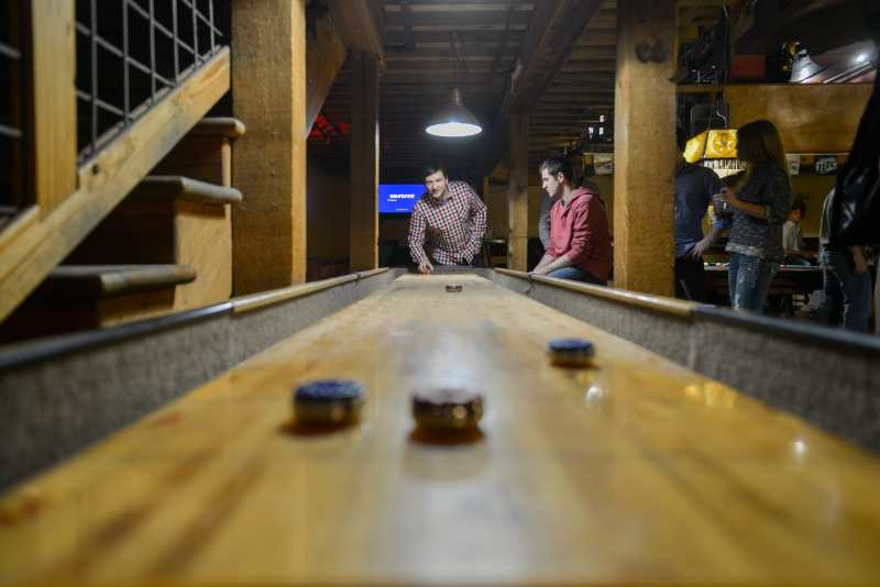 playing shuffleboard indoors