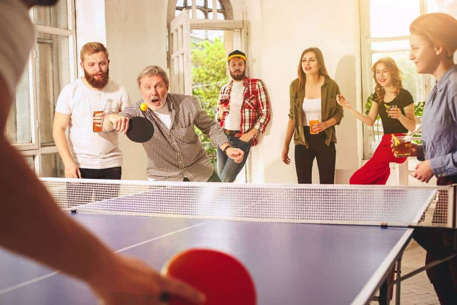 having fun with other games to play on a ping pong table