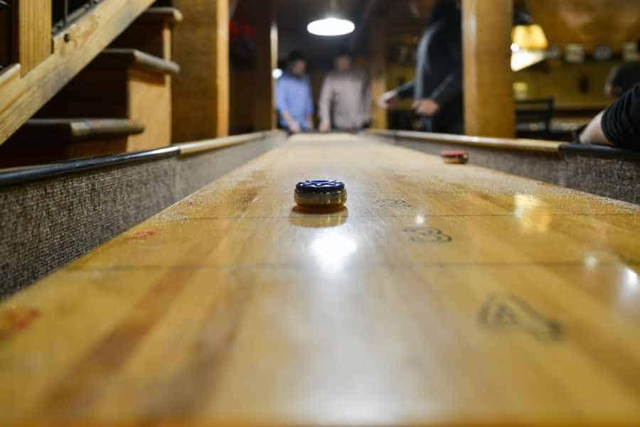 LONG AND HEAVY SHUFFLEBOARD TABLE
